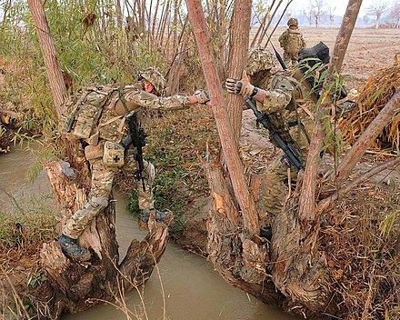 Royal Marines from 40 Commando cross an irrigation ditch in Helmand Province, Afghanistan. 40 Commando irrigation ditch.jpg