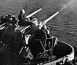76 mm guns firing on USS Durham (LKA-114) 1970.jpg