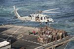A U.S. Navy MH-60S Seahawk helicopter assigned to Helicopter Sea Combat Squadron (HSC) 22 picks up cargo from the fast combat support ship USNS Arctic (T-AOE 8) for delivery to the aircraft carrier USS Harry S 140307-N-RY581-166.jpg