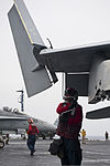 A U.S. Sailor lowers the wing of an F-A-18C Hornet aircraft assigned to Strike Fighter Squadron (VFA) 146 on the flight deck aboard the aircraft carrier USS Nimitz (CVN 68) in the Indian Ocean June 8, 2013 130608-N-LP801-075.jpg
