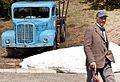 A blue truck and an old man.jpg