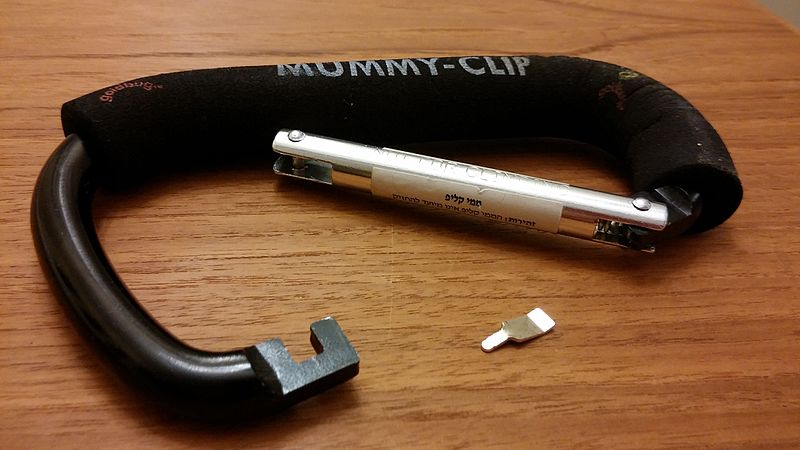 A carabiner (mummy clip) with a broken pin