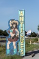 A fetching cowgirl-themed advertising sign for the Wagon Wheel Antique Mall in the town of Murchison in Henderson County, Texas LCCN2014633353.tif