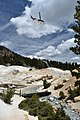 A helicopter carries a slingload of old boardwalk material above Bumpass Hell Basin (6327af1c-99a6-47fa-bfc3-9c10edb2571c).jpg