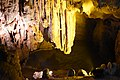 A large cave inside the Sung Sot cave is brightly flood lit (31489274102).jpg
