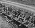 A new shift reports for duty at the TVA's new Douglas Dam on the French Broad River. - NARA - 196450.tif