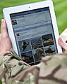 A serviceman accesses social media channels using an iPad, outside MOD Main Building in London MOD 45156048.jpg