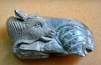 Nimrud ivories - A supine bull, one of the Nimrud ivories found by Sir Max Mallowan, The Sulaymaniyah Museum, Iraq.