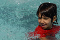 A young Iraqi girl swims in the new swimming pool that opened in Risalah, Baghdad, Iraq, Sept. 18, 2008 080918-N-KM397-076.jpg