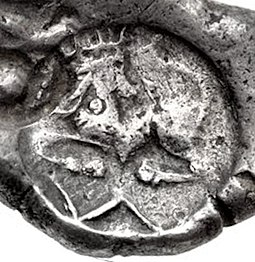 A siglos found in the Kabul valley, 5th century BCE. Coins of this type were also found in the Bhir Mound hoard. Achaemenid siglos Kabul.jpg