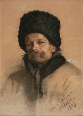 Portret chłopa w futrzanej czapie