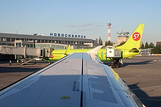 Tolmachevo Airport - S7 Airlines Boeing 737-800 at Tolmachevo Airport, parked next to air bridge