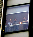 Alain Robert ascend of New York Times Building - 17 - NYTD developers watch crowd from 8th floor.png