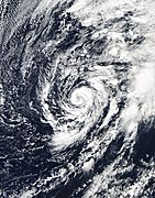A cyclone with banding clouds wrapping cyclonically over its center