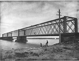 An Intercolonial Railway bridge, 1875. The railway was established as a result of Confederation. Alexander Henderson, Intercolonial Railway bridge at Sackville, NB, 1875.jpg