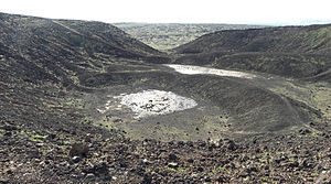 Amboy Crater - Interior of Amboy Crater showing a lava lake and the distant breach in the cinder cone rim.