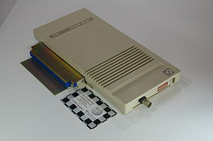 ARCNET - An ARCNET adapter for an Amiga 500 computer. The small card next to it is the size of a credit card