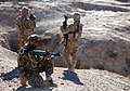 An Afghan National Army soldier provides security with U.S Soldiers.jpg