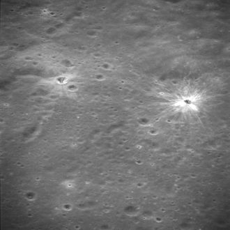 Apollo 16 - Oblique closeup of the proposed Apollo 16 landing site as photographed by Apollo 14 from lunar orbit.  North Ray crater is at left and South Ray crater is at right, with bright rays.