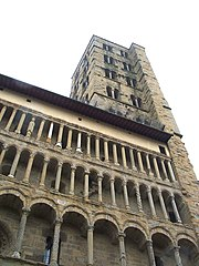 Santa Maria della Pieve, Arezzo, has a screen front with varied tiers of colonettes.