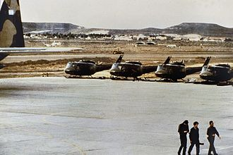 """Argentine Army Aviation - UH-1H Iroquois """"Huey"""" helicopters, at Port Stanley Airport; after transport to the islands by C-130H """"Hercules"""", had not had their rotors reattached yet"""