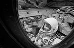 Astronauts L. Gordon Cooper Jr. (foreground) and Charles Conrad Jr. are pictured in their Gemini-5 spacecraft moments before the hatches are closed.jpg