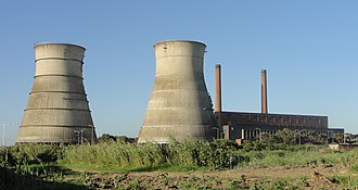 Athlone Power Station - Image of the Power Station before the demolition of the cooling towers. The reinforcing bands on the right tower failed, necessitating the demolition of both towers on 22 August 2010.