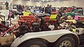 Austin Mini four cylinder engine vs Geo Metro three cylinder engine (16536433816).jpg
