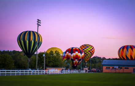 Hot air balloons from across the United States attend this annual two-day event Balloon Festival Harrison, Arkansas.png
