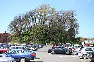 Feudal barony of Barnstaple - The remains of the Norman motte of Barnstaple Castle, seen from the SE, now the backdrop to the Tully St carpark, with Barnstaple library to the right (NE)