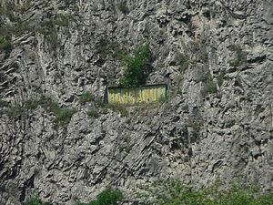 Barrandov Studios - The Barrande sign on Barrandov Rocks