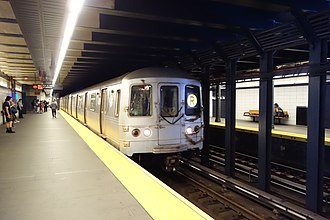 R (New York City Subway service) - An R train of R46s at Bay Ridge Avenue.