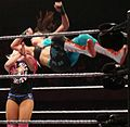 Bayley performing a Diving back elbow on Alexa Bliss.jpg