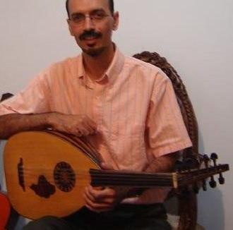 Barbat (lute) - Hossein Behroozinia renowned Iranian musician holding a Persian Barbat