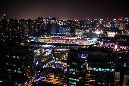 Beijing Workers' Stadium at night as viewed from Sanlitun Beijing Workers' Stadium.jpg