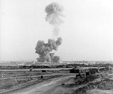 a mushroom cloud rises hundreds of feet from the site of the 1983 Beruit barracks bombing