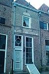 foto van Huis met gepleisterde rechte gevel
