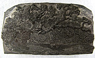 Wood engraving - The block shown from above. Notice the circular area marking damaged and repaired wood on the left next to the figure of a man.