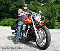 Biker with orange motorcycle.jpg