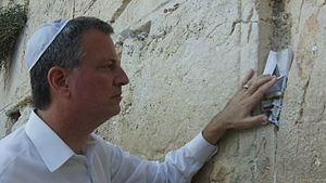 Placing notes in the Western Wall - Then New York City Public Advocate, and now current Mayor of New York Bill de Blasio places a prayer note in the Western Wall, 2011