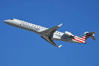 Envoy Air - An American Eagle Bombardier CRJ-700 departing Los Angeles International Airport, California (2014).