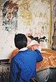 Boy in fromt of mural at Monastery of Saint John's.jpg