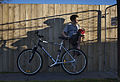 Boy with a bicycle against a wooden fence, Auckland - 0162.jpg