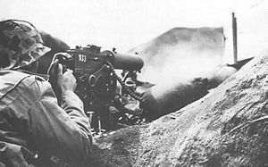 U.S. Marine Browning M1917 machine gun firing at the Japanese