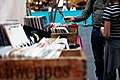 Browsing vinyl music at a fair (Unsplash).jpg