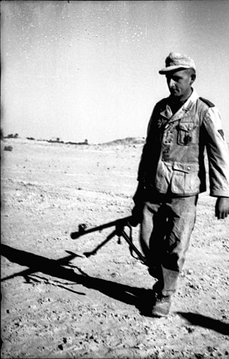 90th Light Infantry Division (Wehrmacht) - Division infantryman carrying anti-tank rifle in north African desert