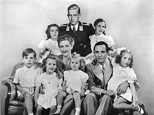 Magda Goebbels - The Goebbels family in 1942: (back row) Hildegard, Harald Quandt, Helga; (front row) Helmut, Hedwig, Magda, Heidrun, Joseph and Holdine. (In this well-known manipulated image, the visage of the uniformed Harald, who was actually away on military duties, was inserted and retouched.)