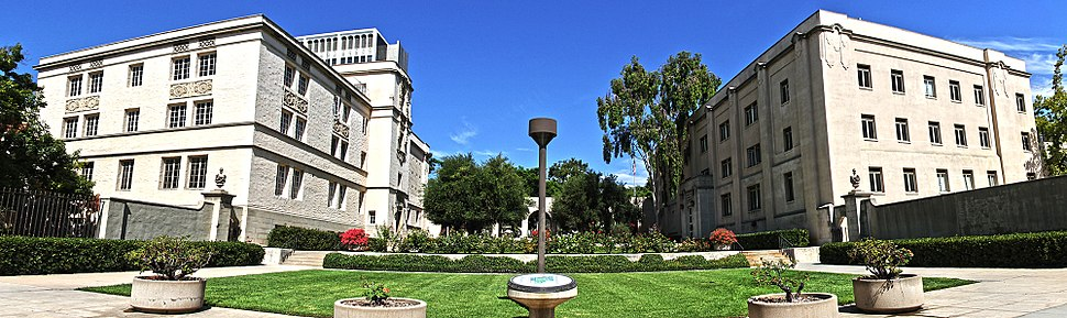 Caltech entrance at 1200 E California Blvd. On the left is East Norman Bridge Laboratory of Physics and on the right is the Alfred Sloan Laboratory of Mathematics and Physics.