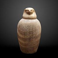 Canopic jar of Uahibre with falcon plug-MAHG 022007 a b-IMG 1801-gradient.jpg