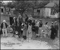 Centerville, California. Farm families of Japanese ancestry awaiting evacuation buses which will ta . . . - NARA - 537576.tif